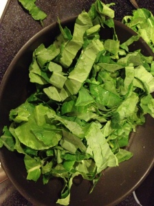 Add greens to pan after sauteeing garlic and peppers.photo credit: Words Etc.